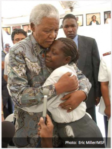 Mandela and Babalwa embracing each other after Babalwa's brave speech about how she was infected with HIV.